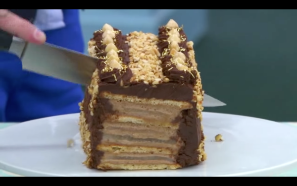Layers of chocolate and meringue, with chopped nuts and flecks of gold