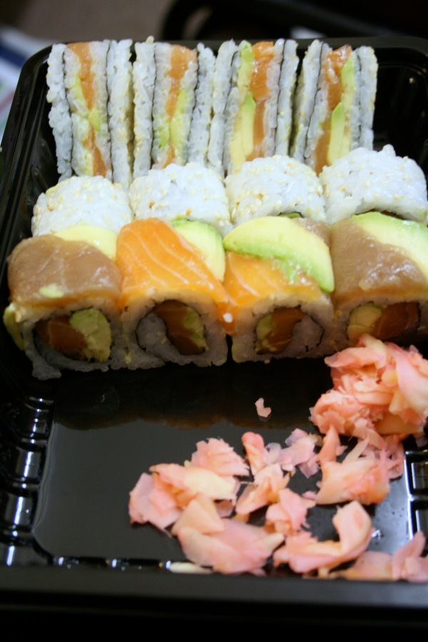 Lovely assortment of salmon samples: fashion sandwiches, California rolls, and Delux rainbox rolls