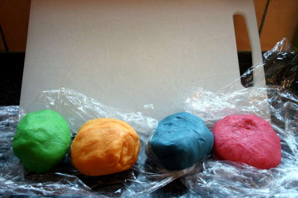 Brightly coloured balls of dough, waiting to be baked together into deliciousness