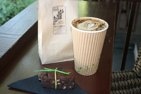 Latté art and a mocha-nut truffle slice. Only 15% flour in that brownie chunk of gold