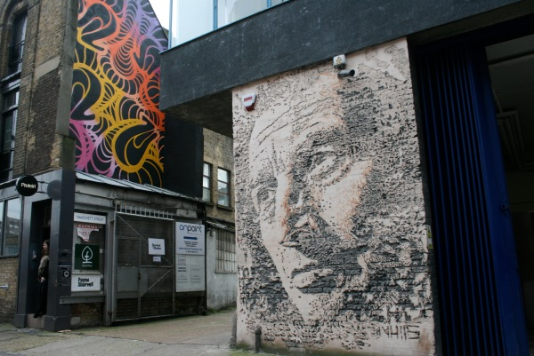 This piece on the right was done by Nhils using explosives in plaster. Street art isn't just about a spray can