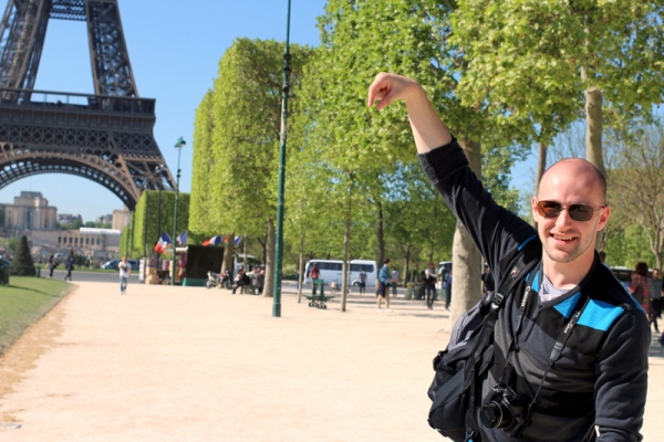 Check: he's holding the Eiffel Tower!