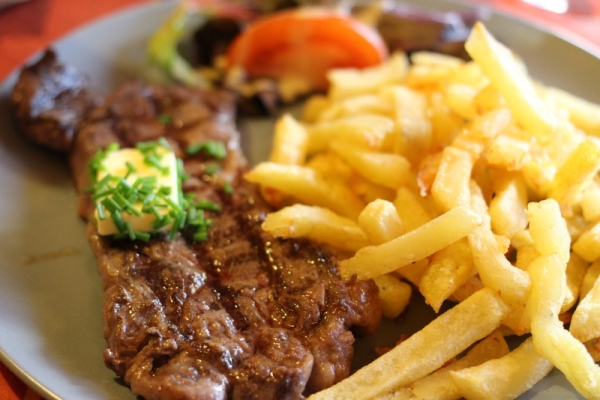 The classic French dinner: Sirloin and Pommes Frites (French Fries). The irony that they are called Poms...